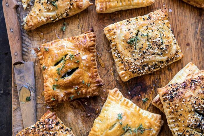 overhead horizontal photo of Caramelized Onion, Spinach, and Cheddar Flaky Pastries