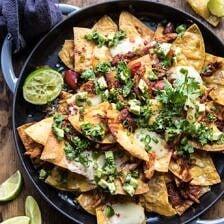 Chipotle Braised Chicken Nachos | halfbakedharvest.com #nachos #gamedayrecipe #football #fallrecipes #chickenrecipes