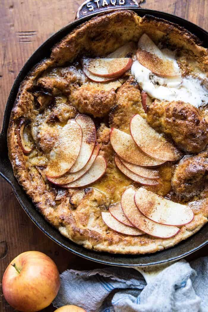 overhead close up photo of Cinnamon Apple Puffed Pancake in skillet