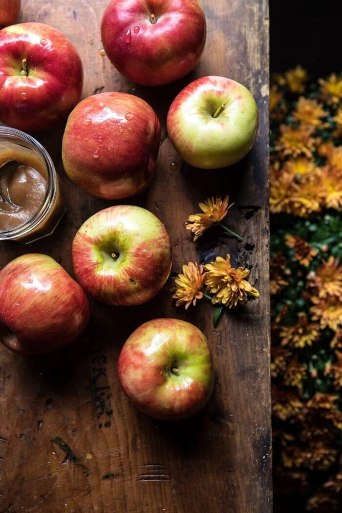 raw apples with flowers in photos