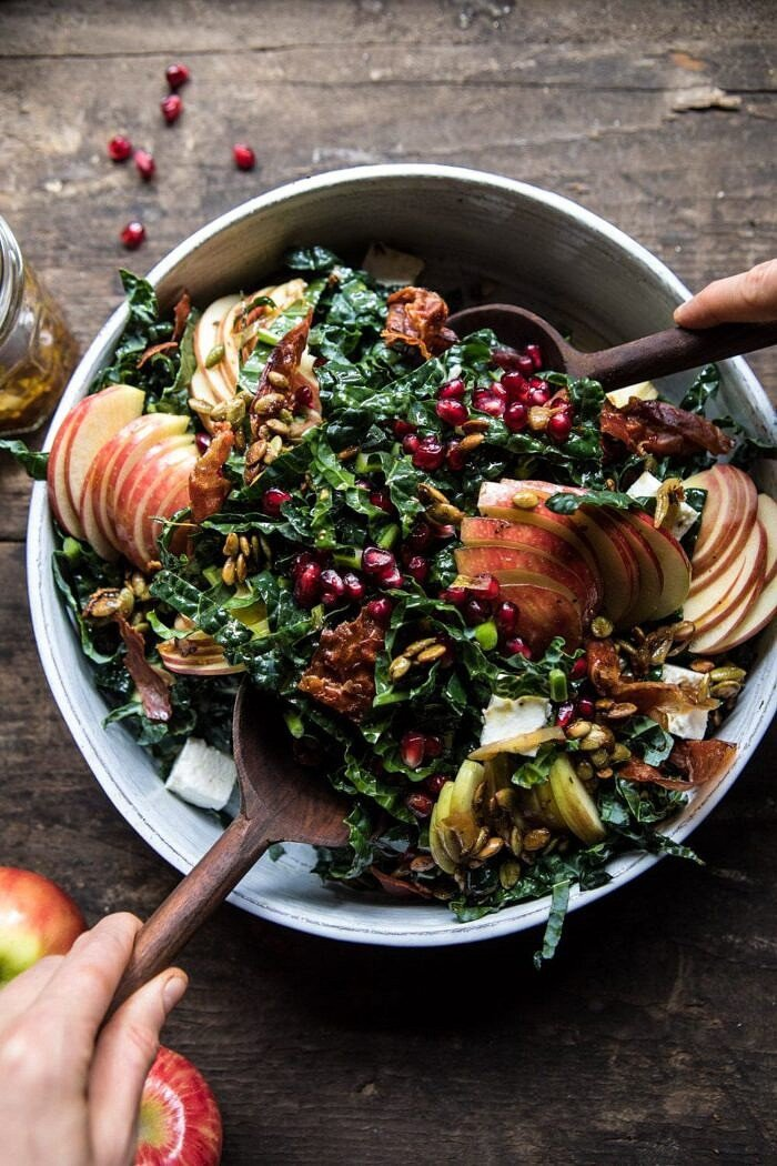overhead photo of Fall Harvest Honeycrisp Apple and Kale Salad being tossed with salad tong