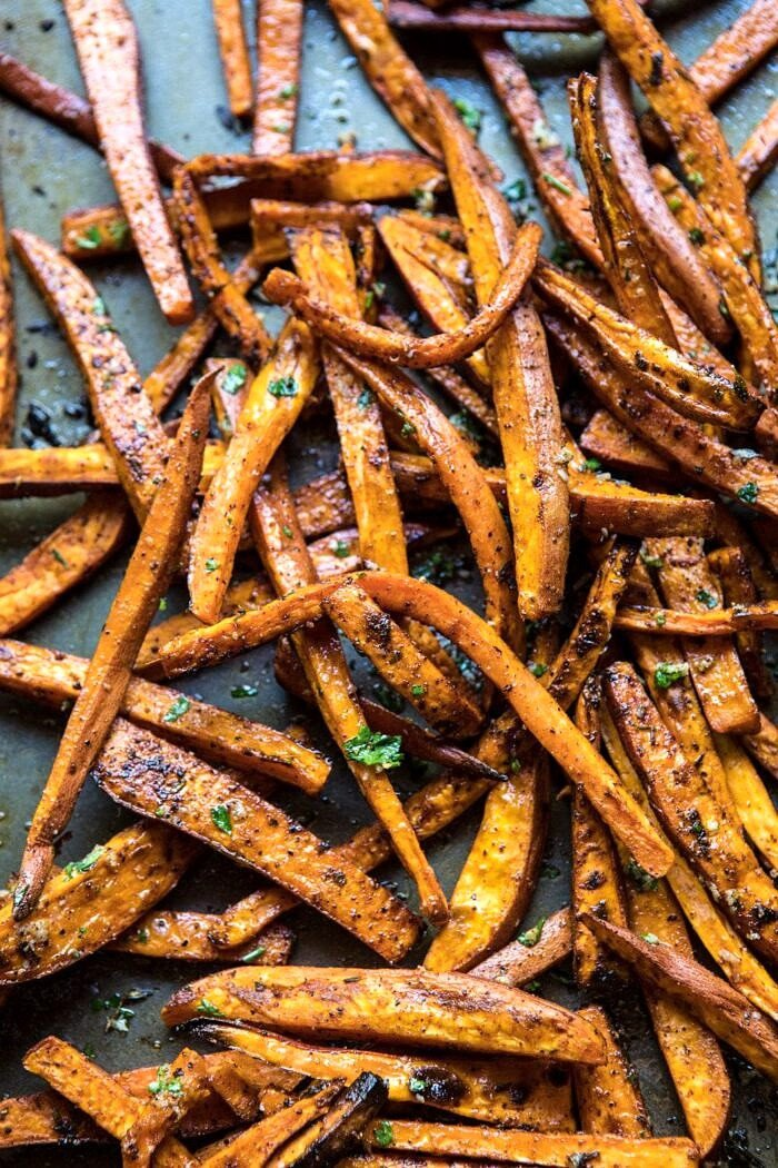 overhead photo of sweet potatoes fries on baking sheet after baking