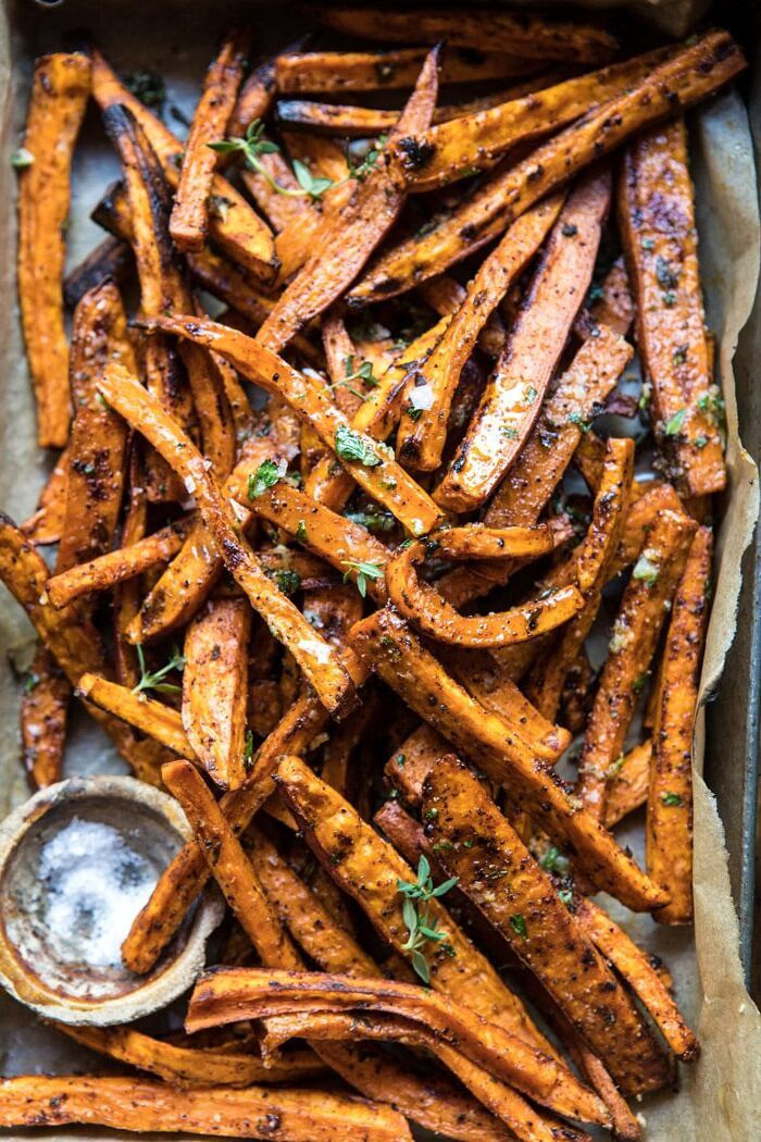 overhead close up photo of Herb Butter Baked Sweet Potato Fries in serving dish