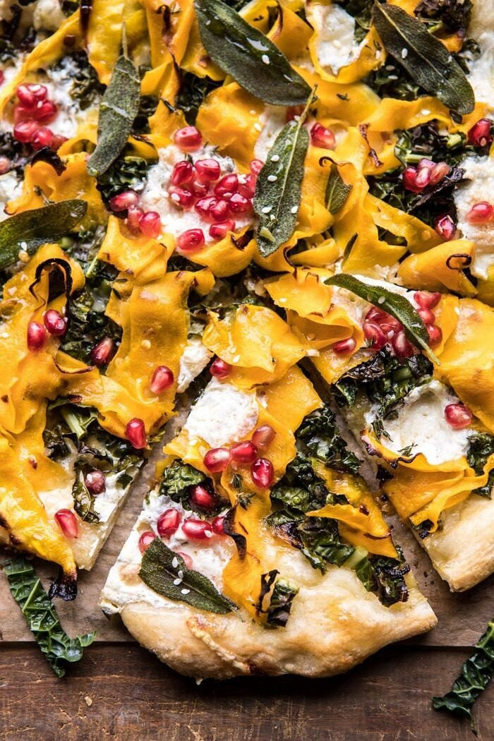 close up photo of Caramelized Onion, Butternut Squash, and Crispy Kale Pizza with piece cut out