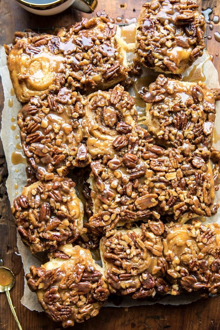 overhead photo of Extra Sticky Maple Pecan Sticky Buns with coffee mug in photo