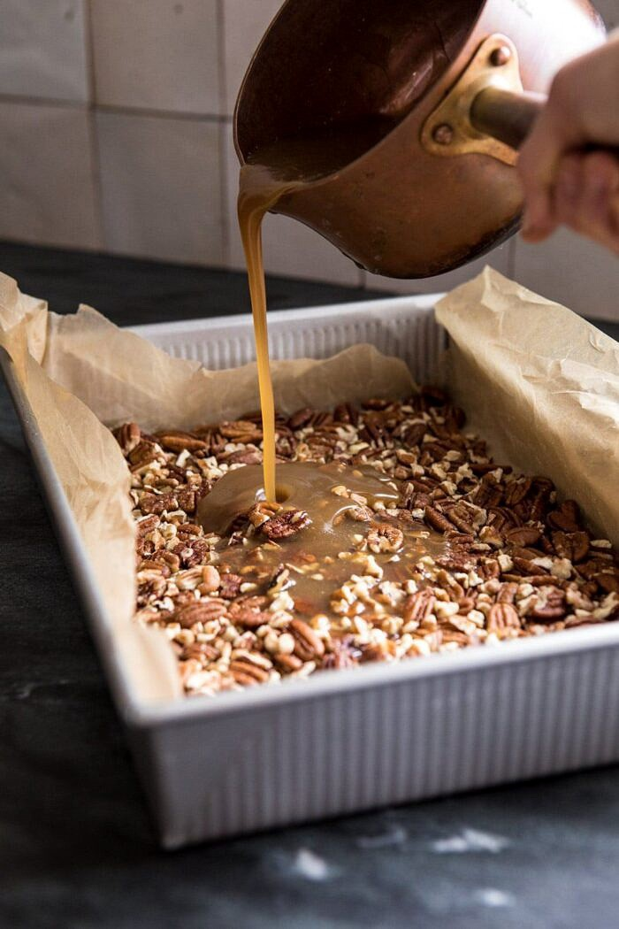 pouring sticky sauce over pecans
