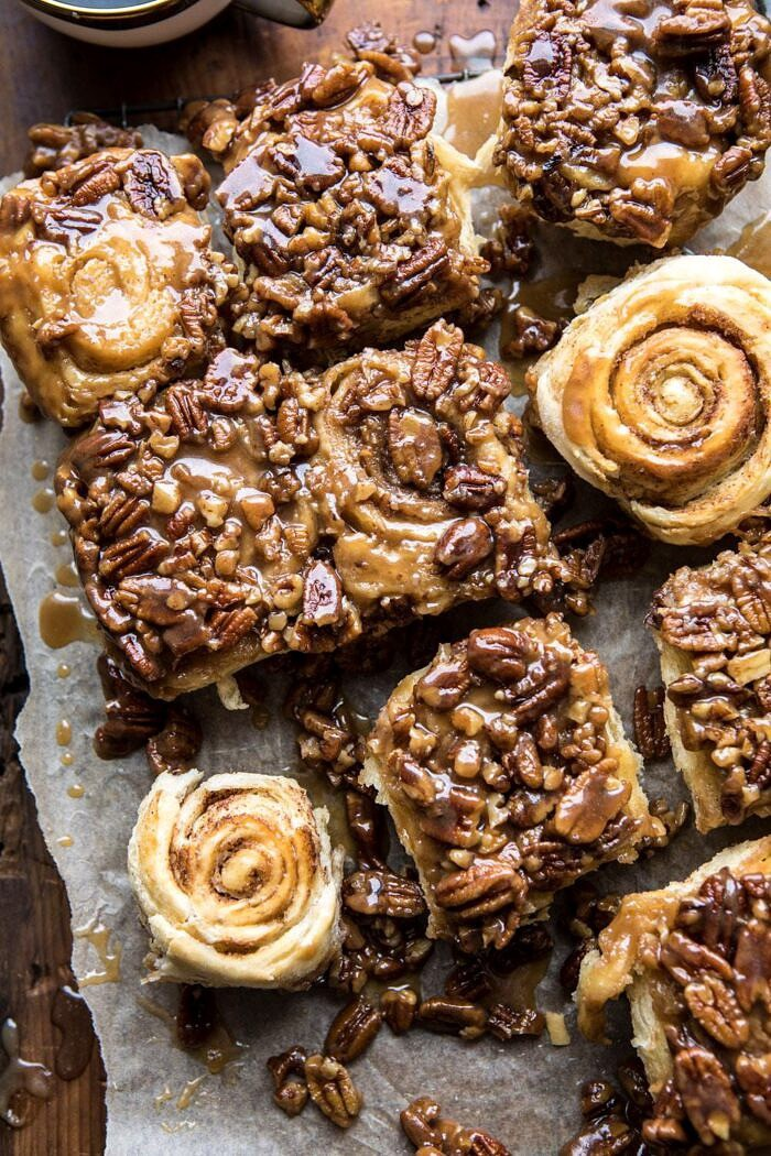 overhead photo of Extra Sticky Maple Pecan Sticky Buns with 2 buns flipped upside to show their swirl