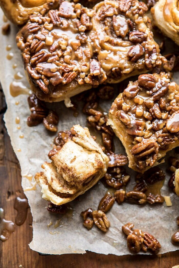 overhead photo of Extra Sticky Maple Pecan Sticky Buns with sticky bun torn in half to expose the center