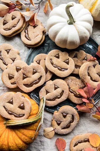 Milk Chocolate Stuffed Jack-O'-Lantern Cookies | halfbakedharvest.com #halloween #thanksgiving #cookies #easyrecipes #chocolate #holidayrecipes #fallrecipes