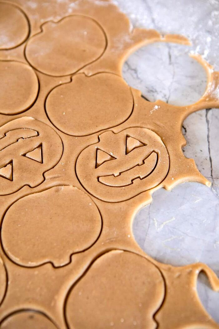 Milk Chocolate Stuffed Jack-O'-Lantern Cookies | halfbakedharvest.com #halloween #thanksgiving #cookies #easyrecipes #chocolate #holidayrecipes #fallrecipes