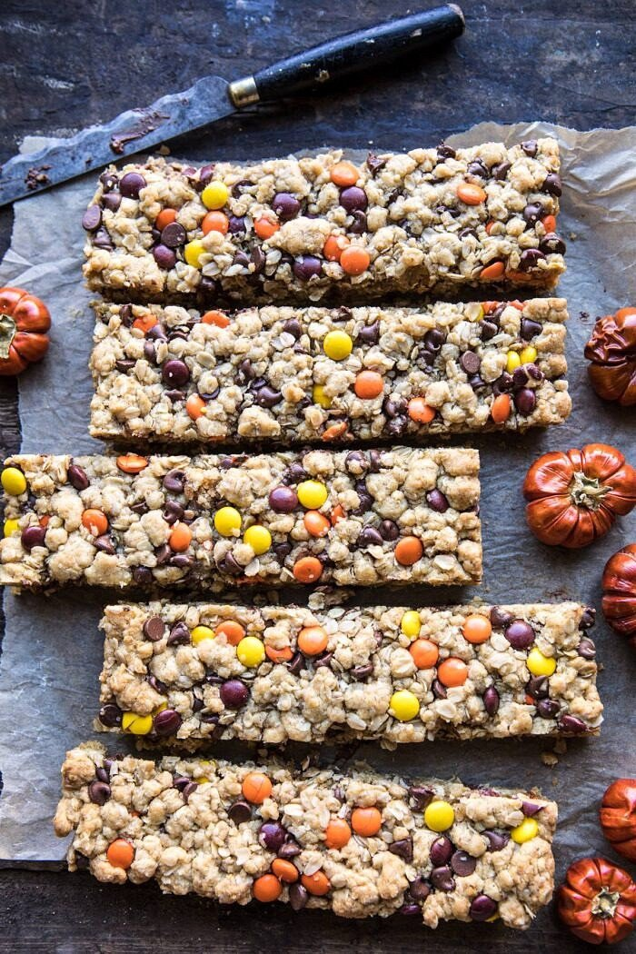 over head photo of Monster Oatmeal Chocolate Chip Cookie Bars with knife and mini pumpkin in photo