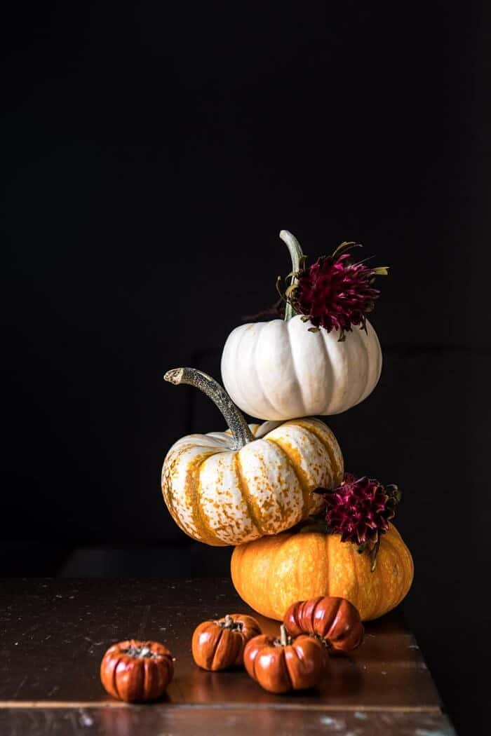 mini pumpkins stacked on top of each other