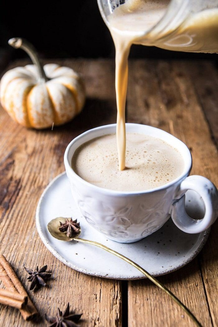 pumpkin milk being poured into mug