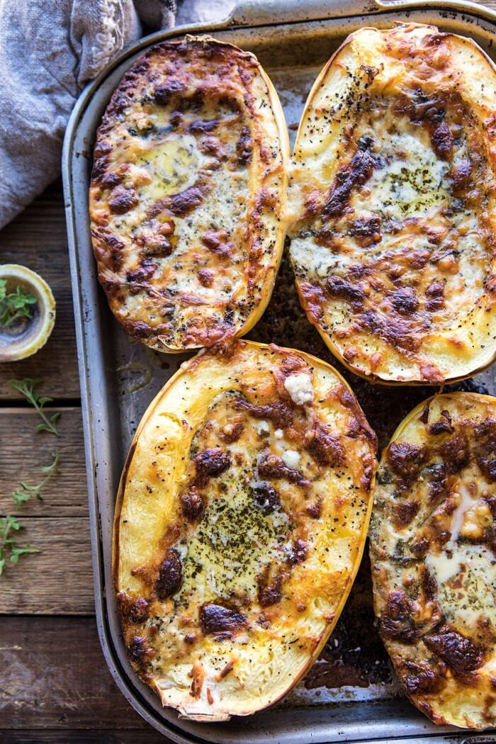 overhead photo of Stuffed Spaghetti Squash 4 Cheese Pesto Lasagna on baking sheet just as they have come out of the oven