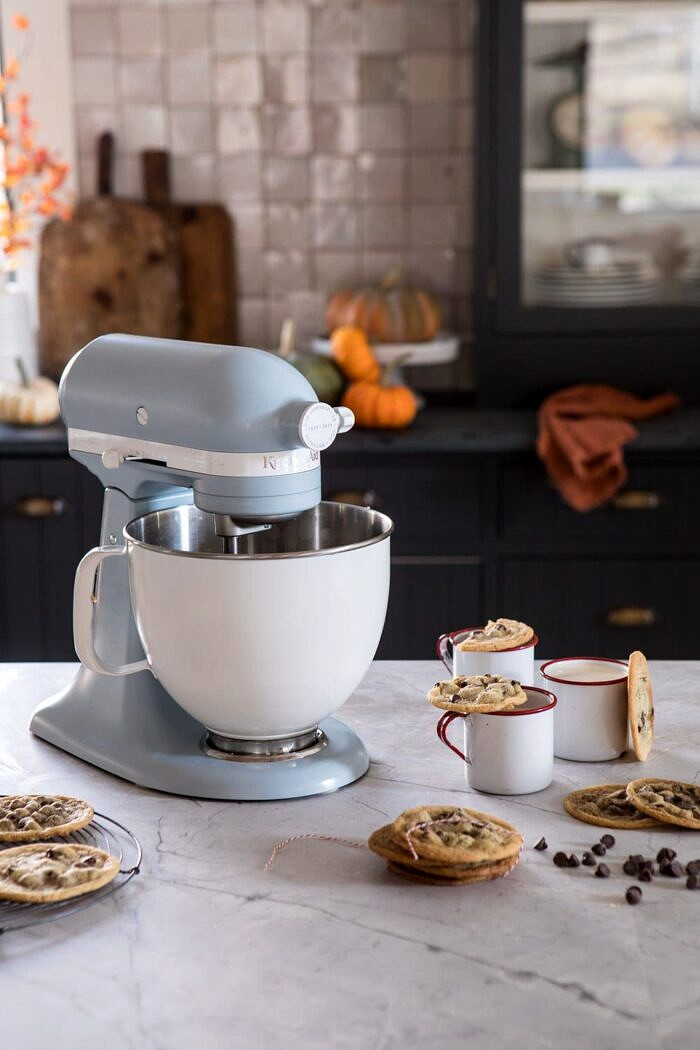 KitchenAid stand mixer sitting on counter with cookies on counter