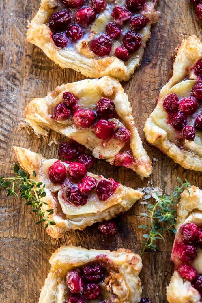 overhead photo Cranberry Brie Pastry Tart cut in half