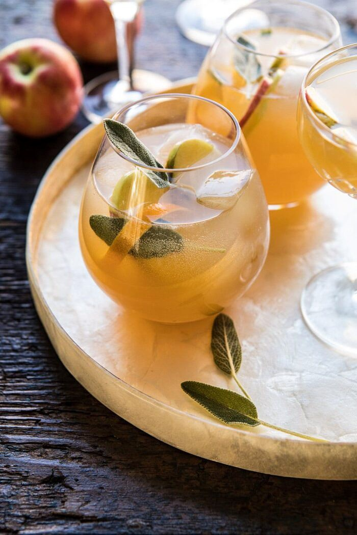 side angle photo Harvest Apple Ginger Spritz with apples and sage in photo