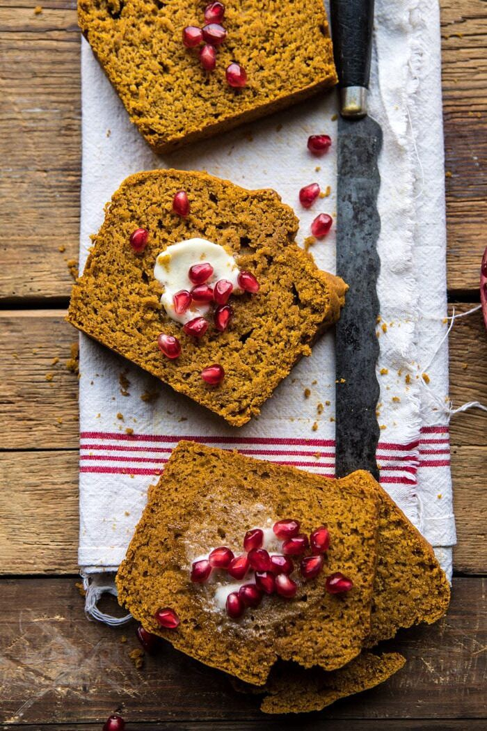 overhead photo of Healthy Pumpkin Ginger Bread slices with butter and pomegranates