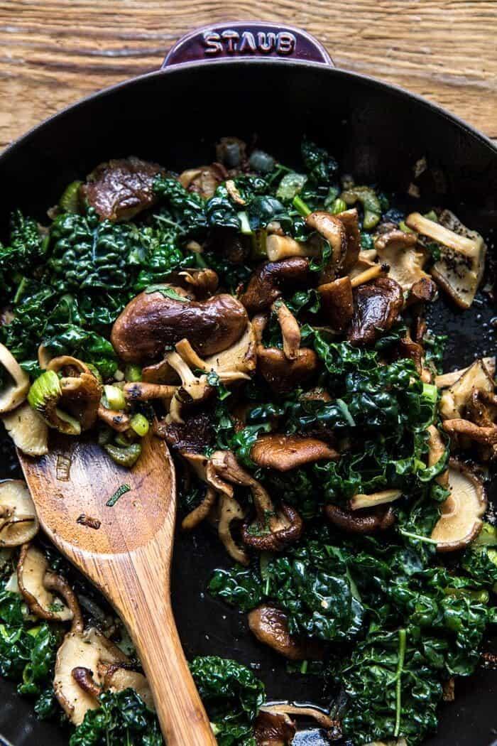 mushrooms and kale in skillet