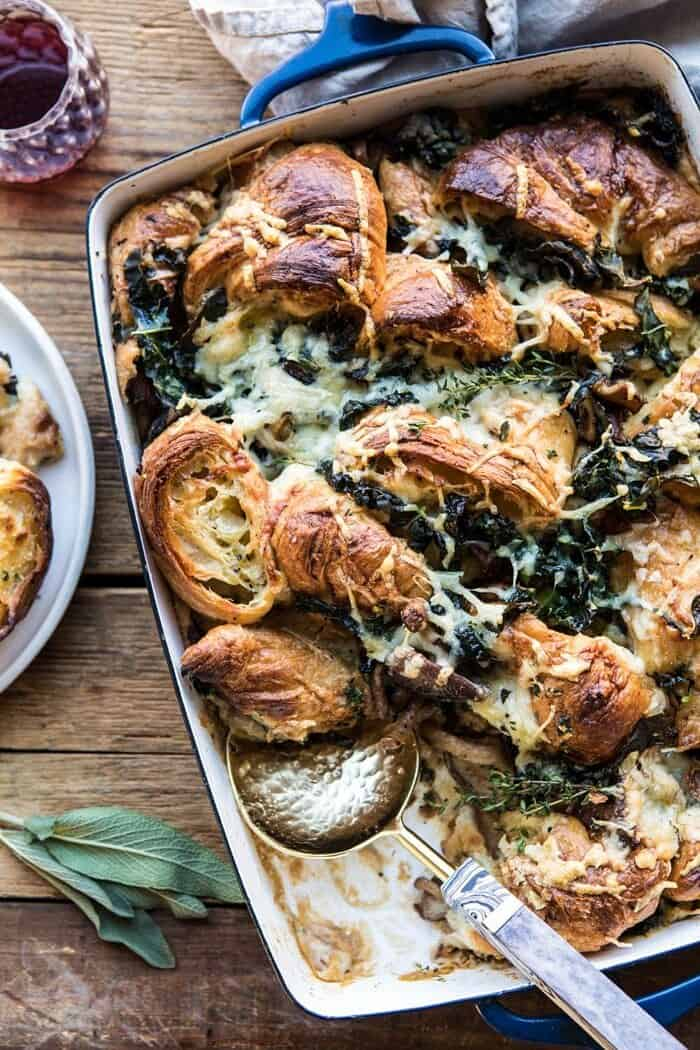 overhead photo of Herby Mushroom Croissant Stuffing with spoon in casserole
