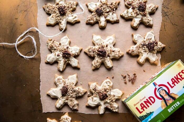 horizontal photo of Pecan Pie Cookies with Butter Pecan Frosting with land O'lakes butter in photo