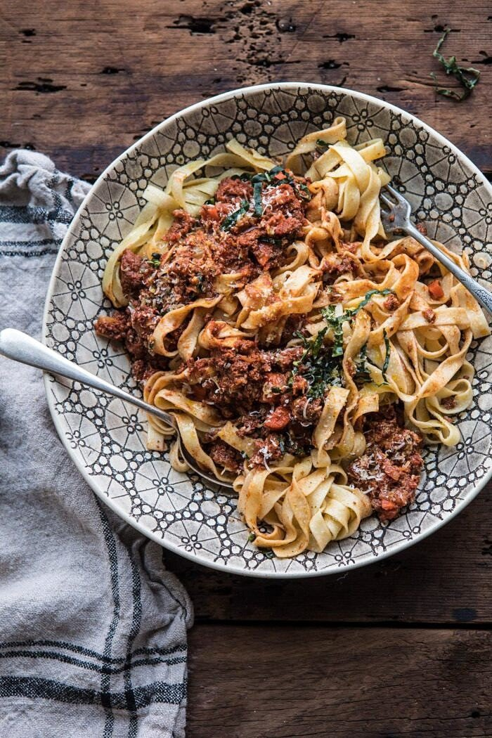 overhead photo of Slow Cooker Vodka Bolognese Pasta tossed together in serving bowl