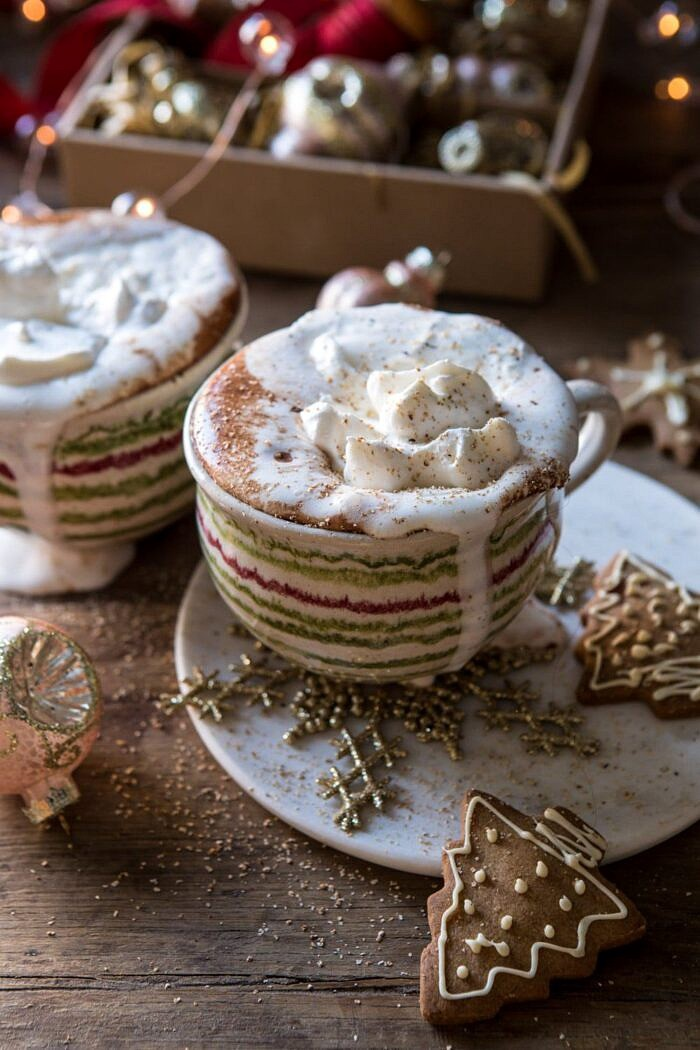 Vanilla Mocha Hot Cocoa with whipped cream dripping down the mugs