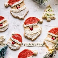 Chai Spiced Santa Cookies with White Chocolate Frosting | halfbakedharvest.com #sugarcookies #christmas #holiday #chai #dessert #easyrecipes