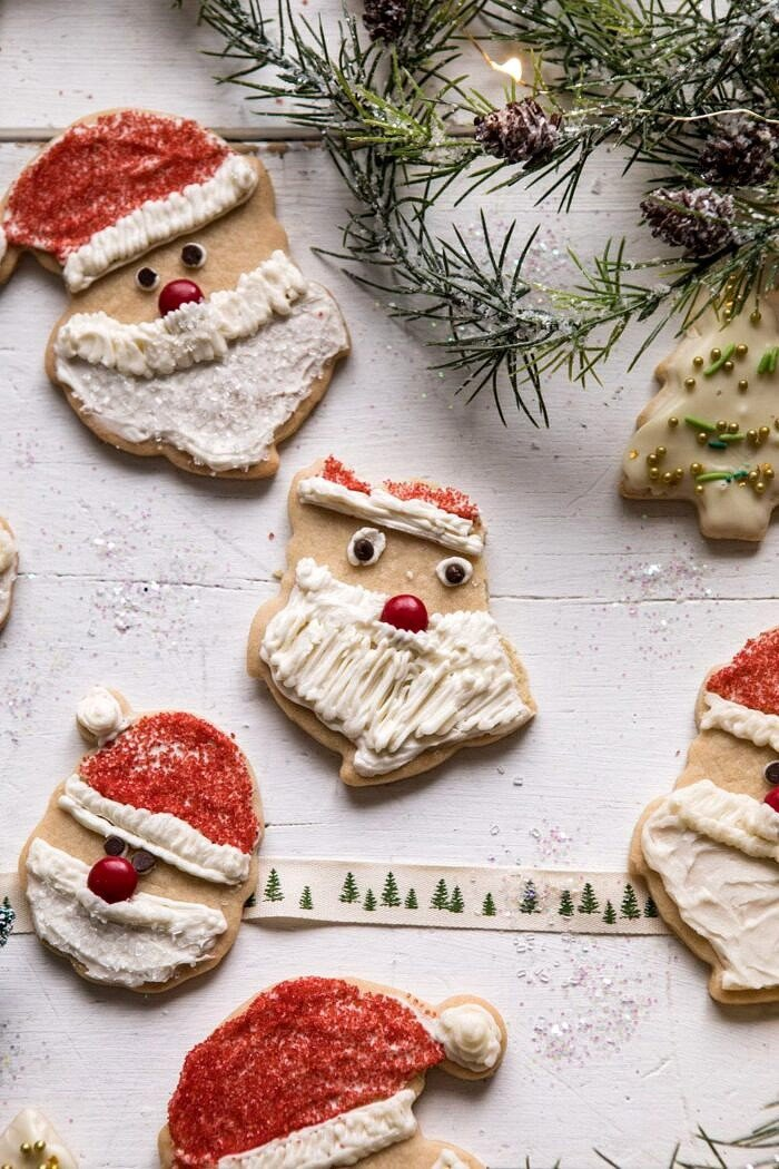 half eaten Chai Spiced Santa Cookies with White Chocolate Frosting