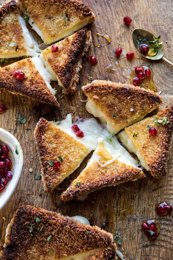 overhead photo of Fried Mozzarella Sandwiches with Pomegranate Honey cut into triangles