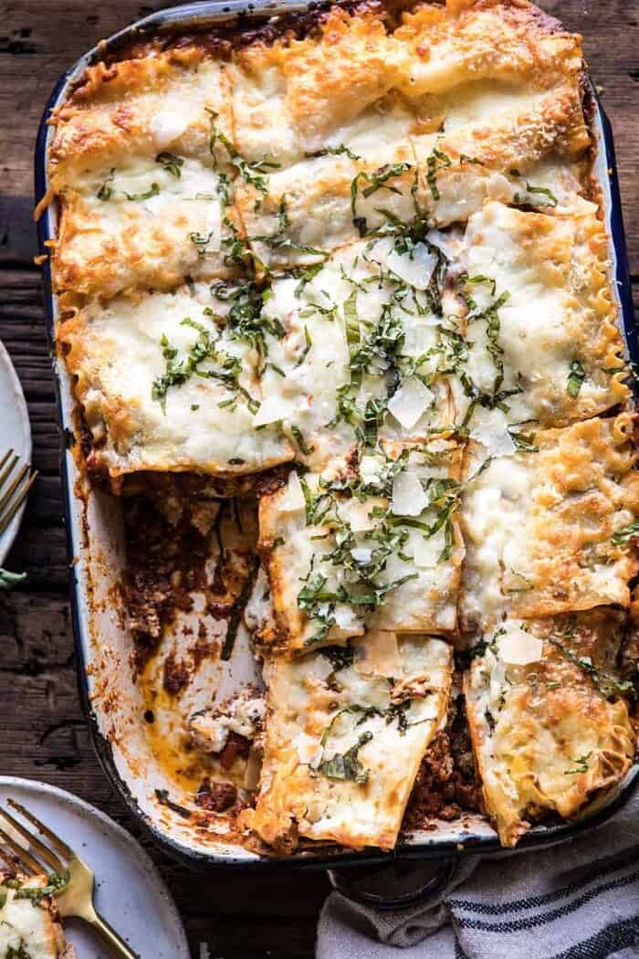 overhead photo of Pesto Bolognese Lasagna with slices cut
