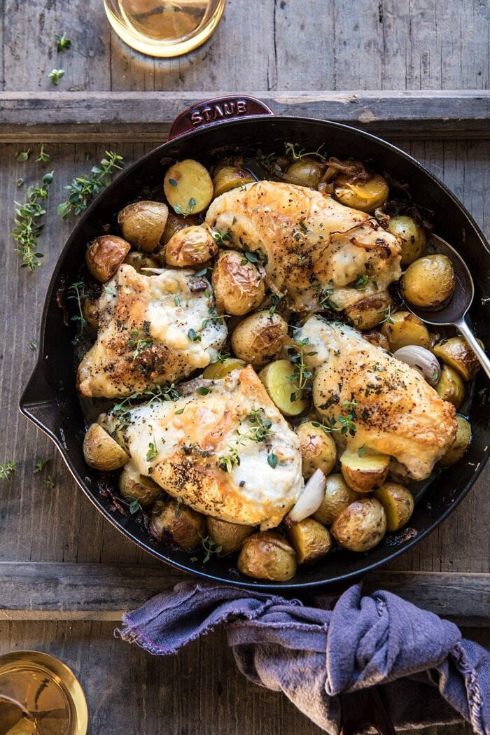 overhead photo of Skillet Roasted French Onion Chicken and Potatoes with wine on table