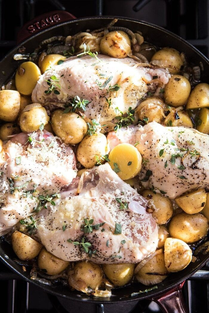 French Onion Chicken and Potatoes in skillet before roasting