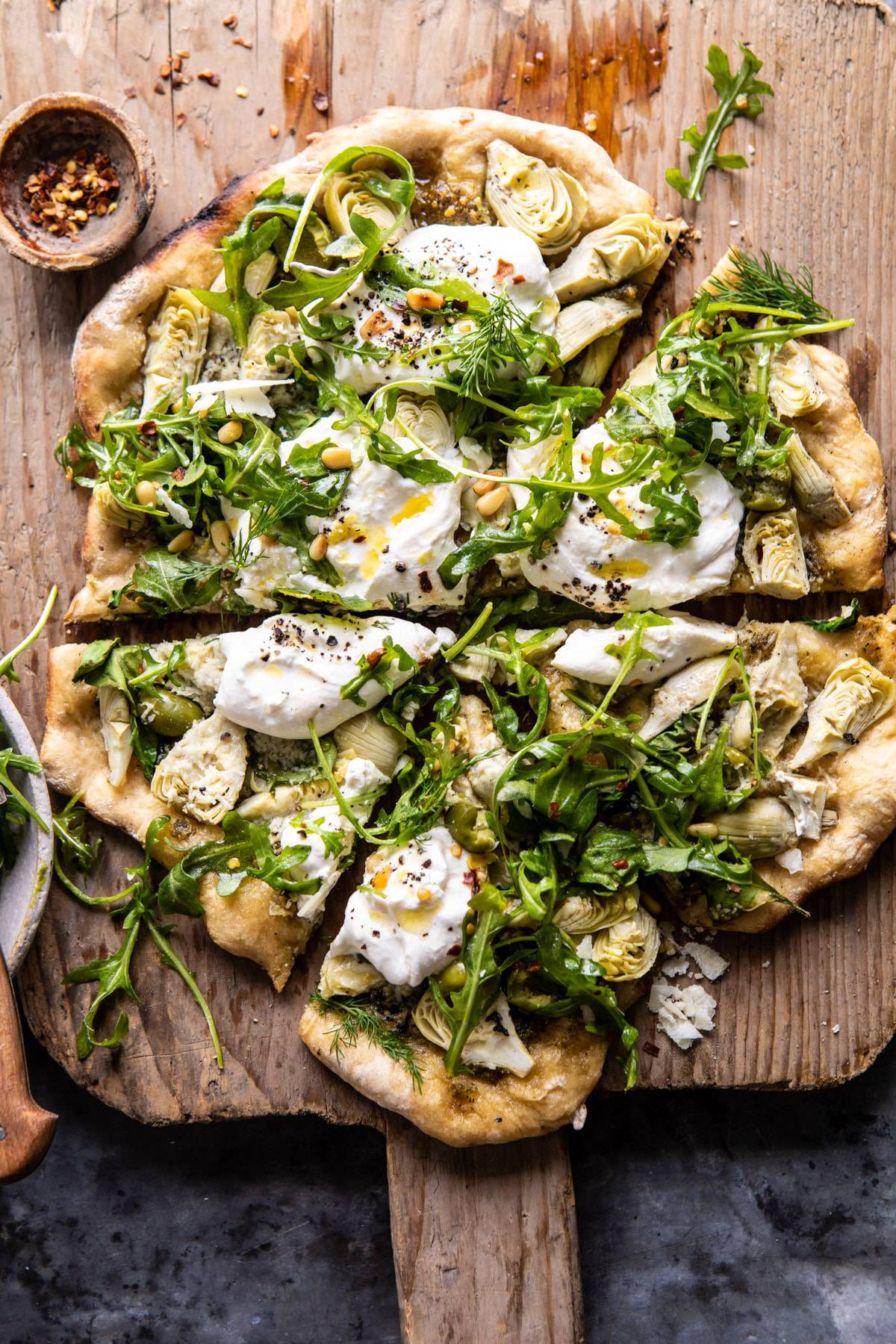 Artichoke Pesto and Burrata Pizza with Lemony Arugula | halfbakedharvest.com #pizza #healthy #burrata #easyrecipes