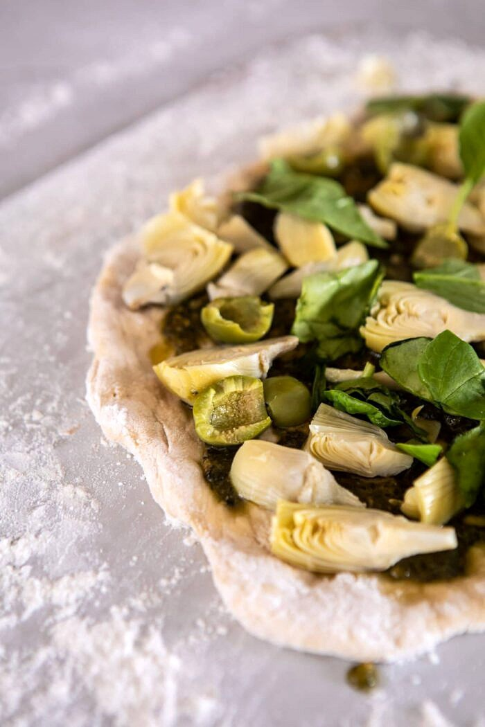 side angled photo Artichoke Pesto and Burrata Pizza before baking