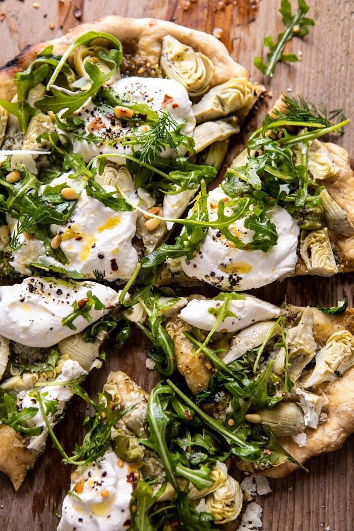 overhead close up photo of Artichoke Pesto and Burrata Pizza with Lemony Arugula