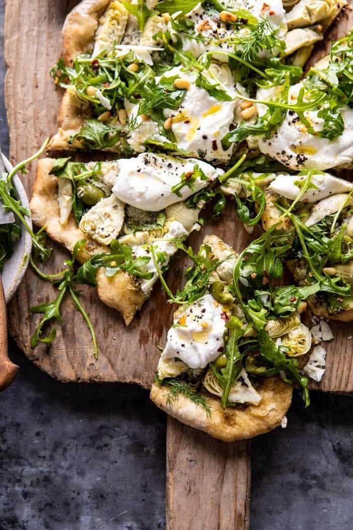close up photo of Artichoke Pesto and Burrata Pizza with Lemony Arugula