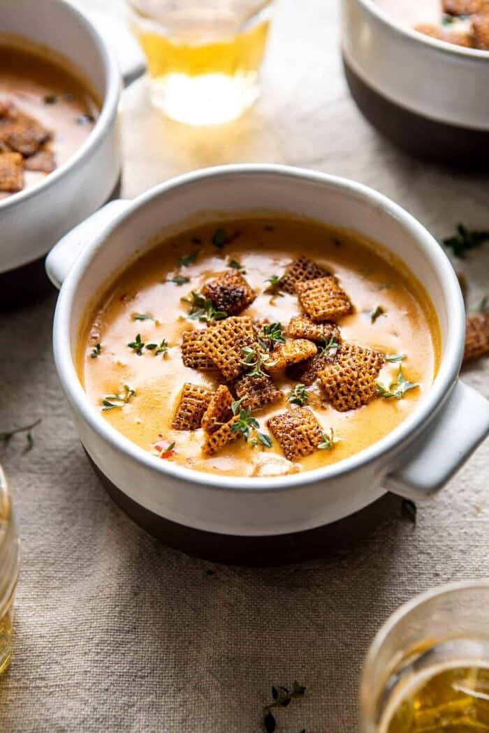 side angled photo of Beer Cheese Soup with Chili Spiced Chex