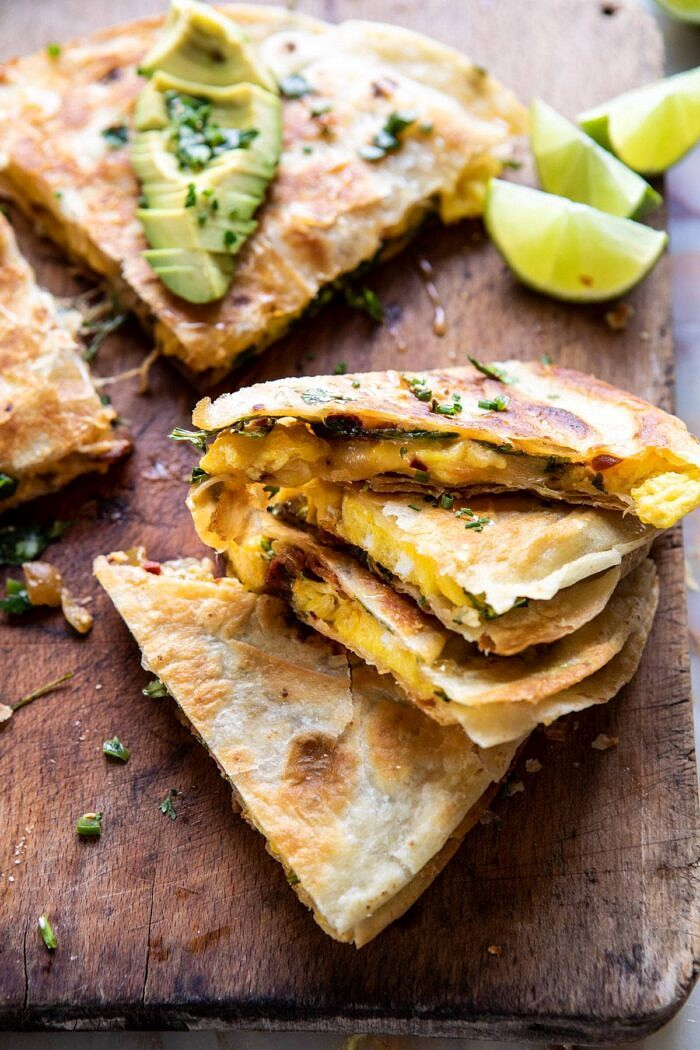 side angle photo of Breakfast Quesadilla with Soft Scrambled Eggs and Avocado Salsa