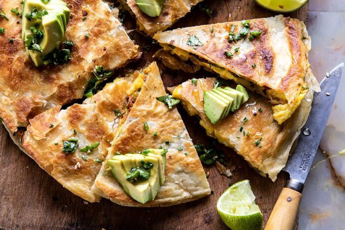 horizontal photo of Breakfast Quesadilla with Soft Scrambled Eggs and Avocado Salsa