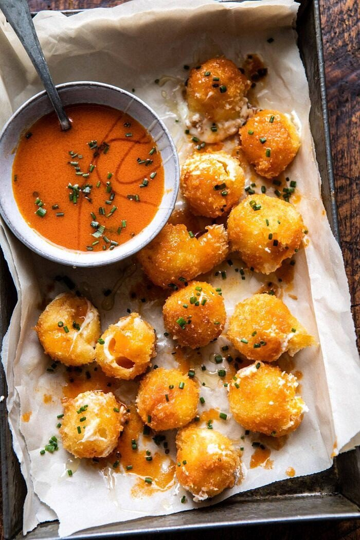 overhead photo of Fried Buffalo Goat Cheese Balls with buffalo sauce in bowl