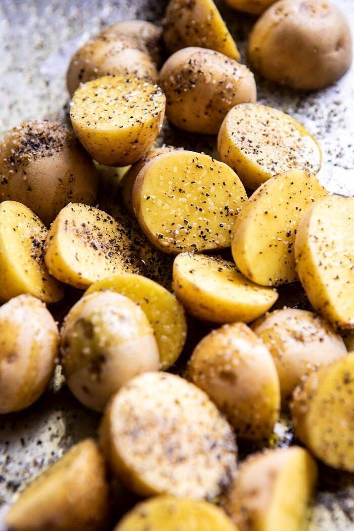 raw potatoes on baking sheet