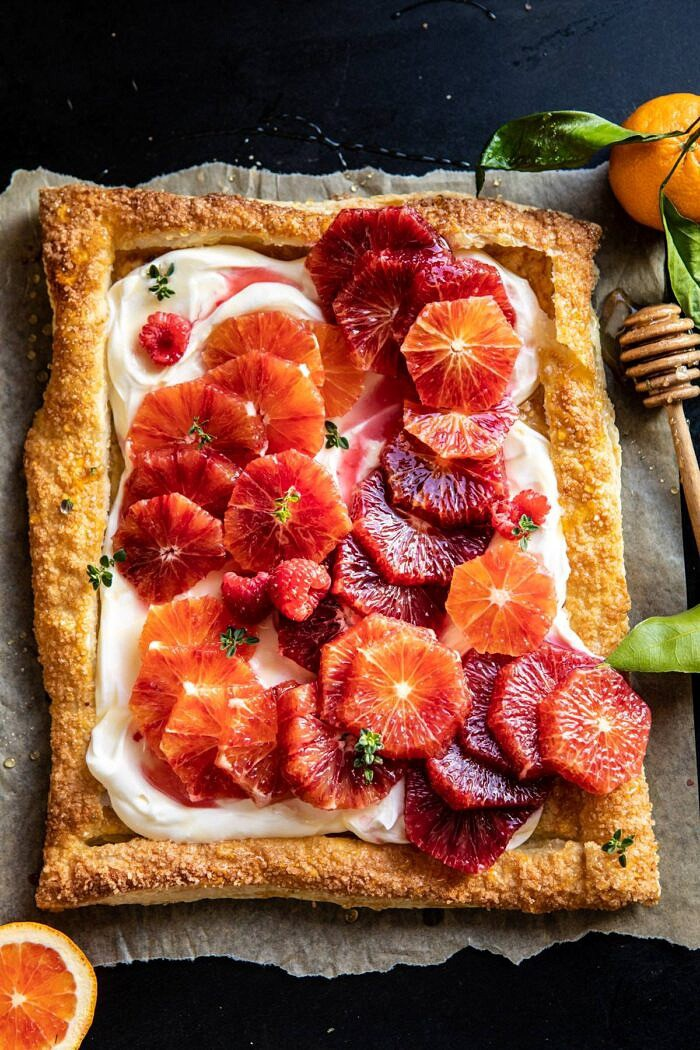 overhead photo of The Simplest Ombrè Citrus Cream Tart with honey drizzler in photo