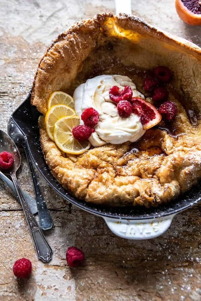 side angle photo of Whole Wheat Dutch Baby in skillet with Meyer Lemon Whipped Ricotta