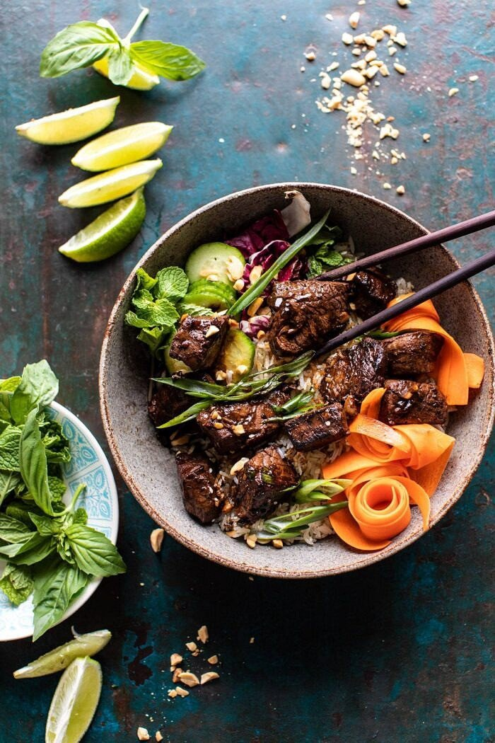 overhead photo of 30 Minute Vietnamese Beef and Crispy Rice Bowl with chopsticks in bowl