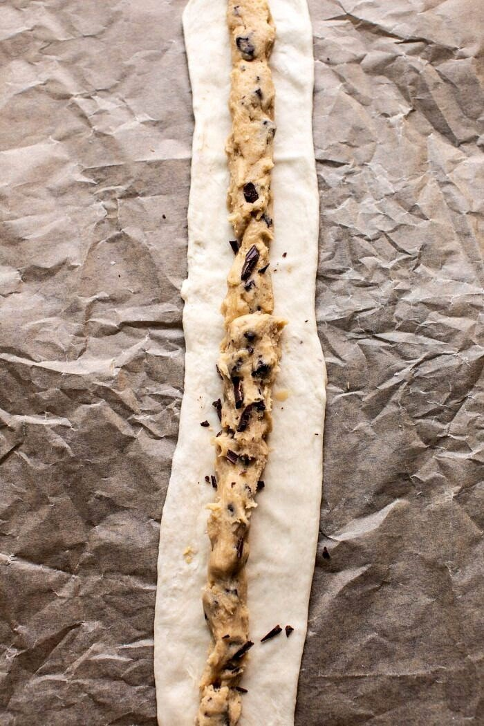 Chocolate Chip Cookie dough on soft pretzel before baking