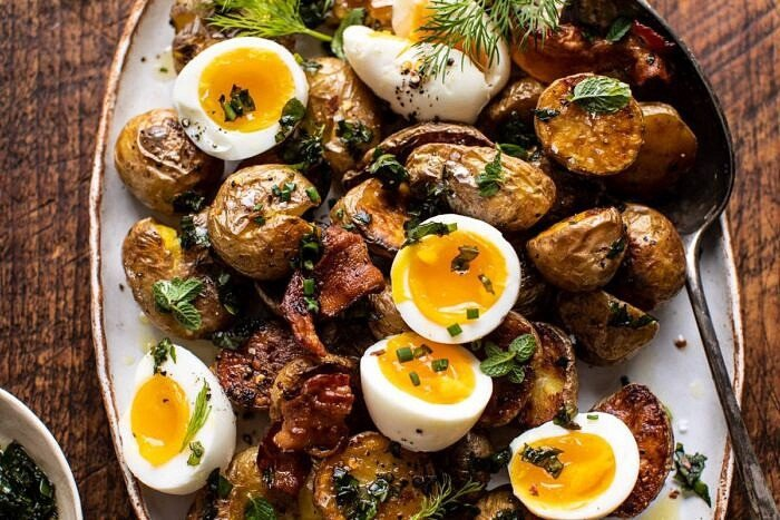 horizontal photo of Crispy Breakfast Potatoes with Chili Garlic Oil and Herbs