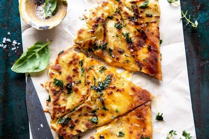 horizontal photo of Garlic Naan Grilled Cheese | halfbakedharvest.com #naan #grilledcheese #easyrecipes