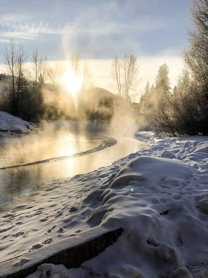 steam coming off the stream with sun in background