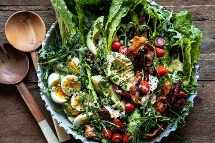horizontal photo of Sun-Dried Tomato Chicken and Avocado Cobb Salad with Tahini Ranch